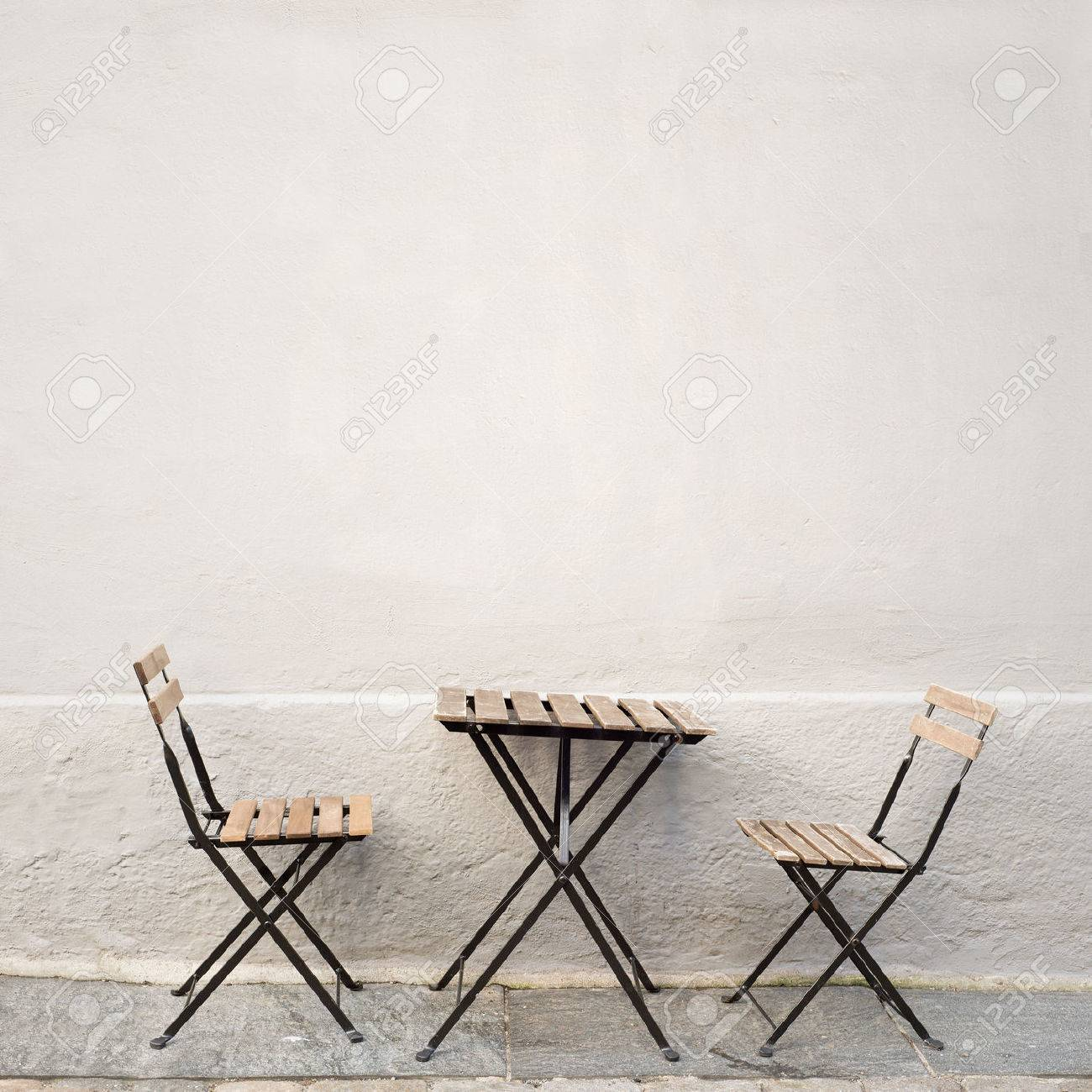 Outdoor Table And Two Chairs Near The Wall At Coffee Shop, Bergen, Norway  Stock