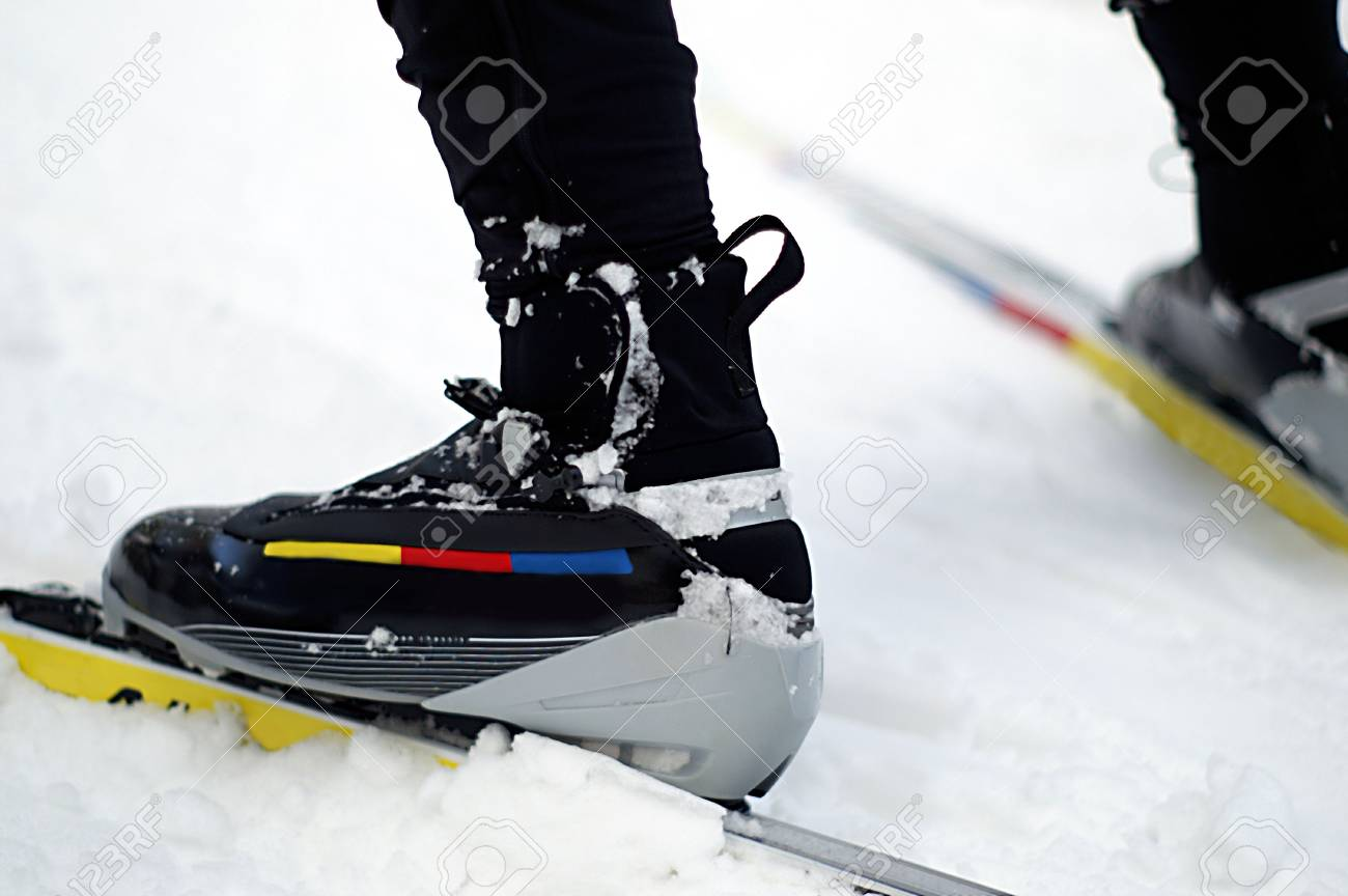 These boots were made for skiing...fast that is. Close up of nordic skating boots, bindings and skis in the snow. - 2651094