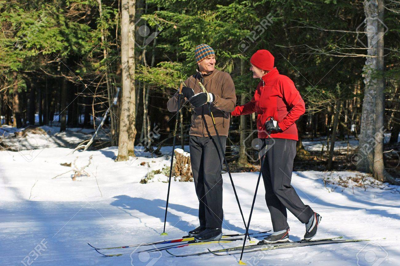 Active baby boomers on nordic skis in Ontario forest - 4346877