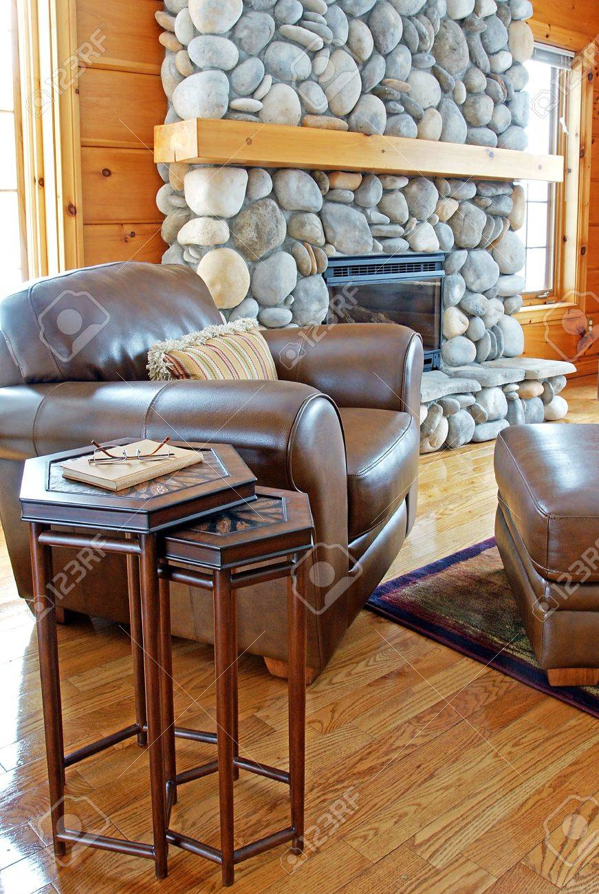 Stupendous A Leather Chair And Ottoman Beside A Riverstone Fireplace In Dailytribune Chair Design For Home Dailytribuneorg