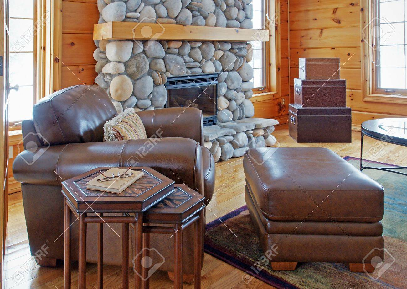 Super A Leather Chair And Ottoman Beside A Riverstone Fireplace In Dailytribune Chair Design For Home Dailytribuneorg