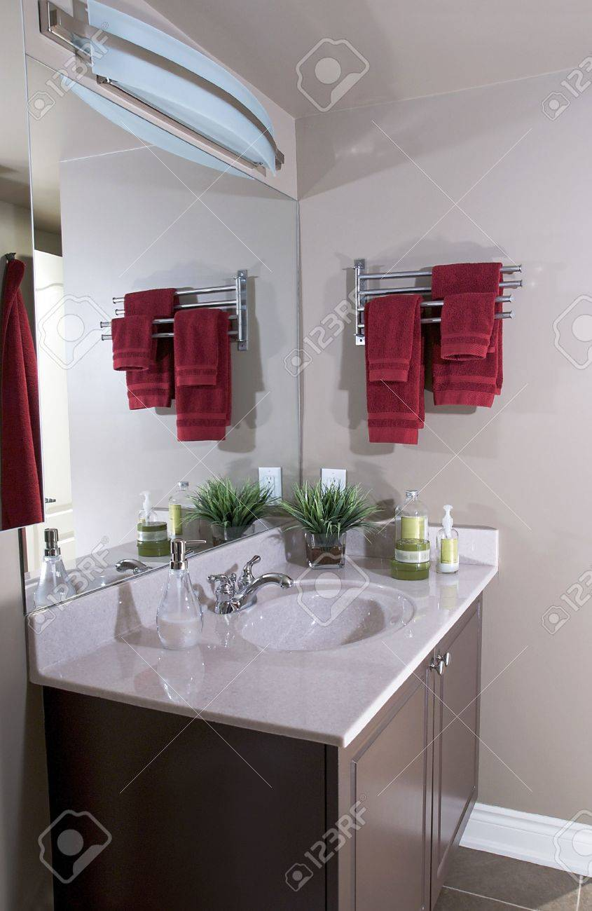 Sink and vanity in a small condominium bathroom - 5805500