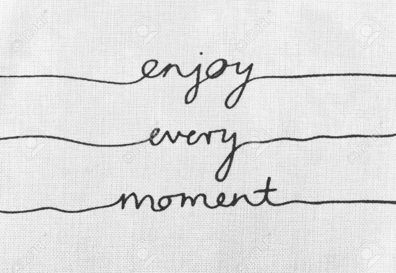 White Canvas Texture With Text Enjoy Every Moment Life Quotes Stock