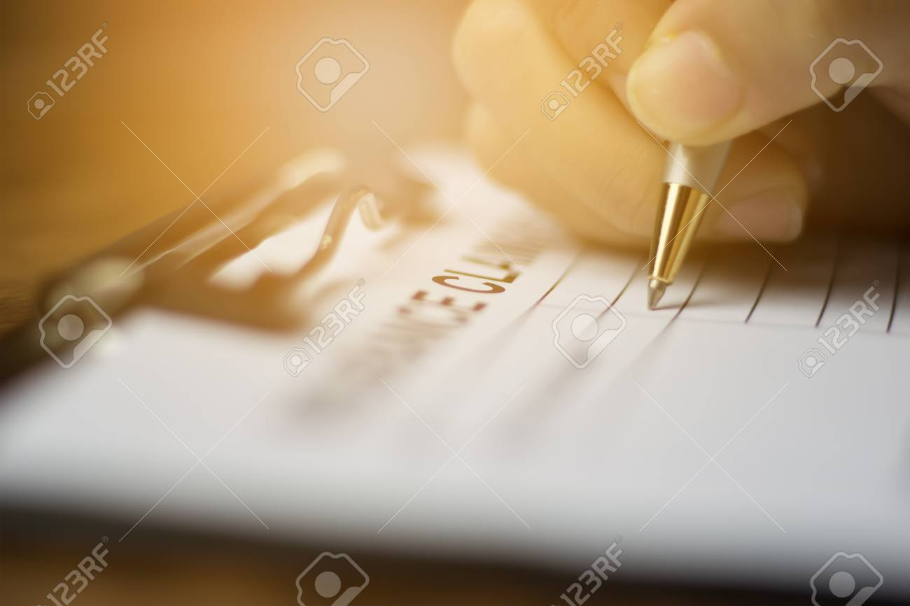 Hand with pen on application form fot registering claim health insurance - 94966497