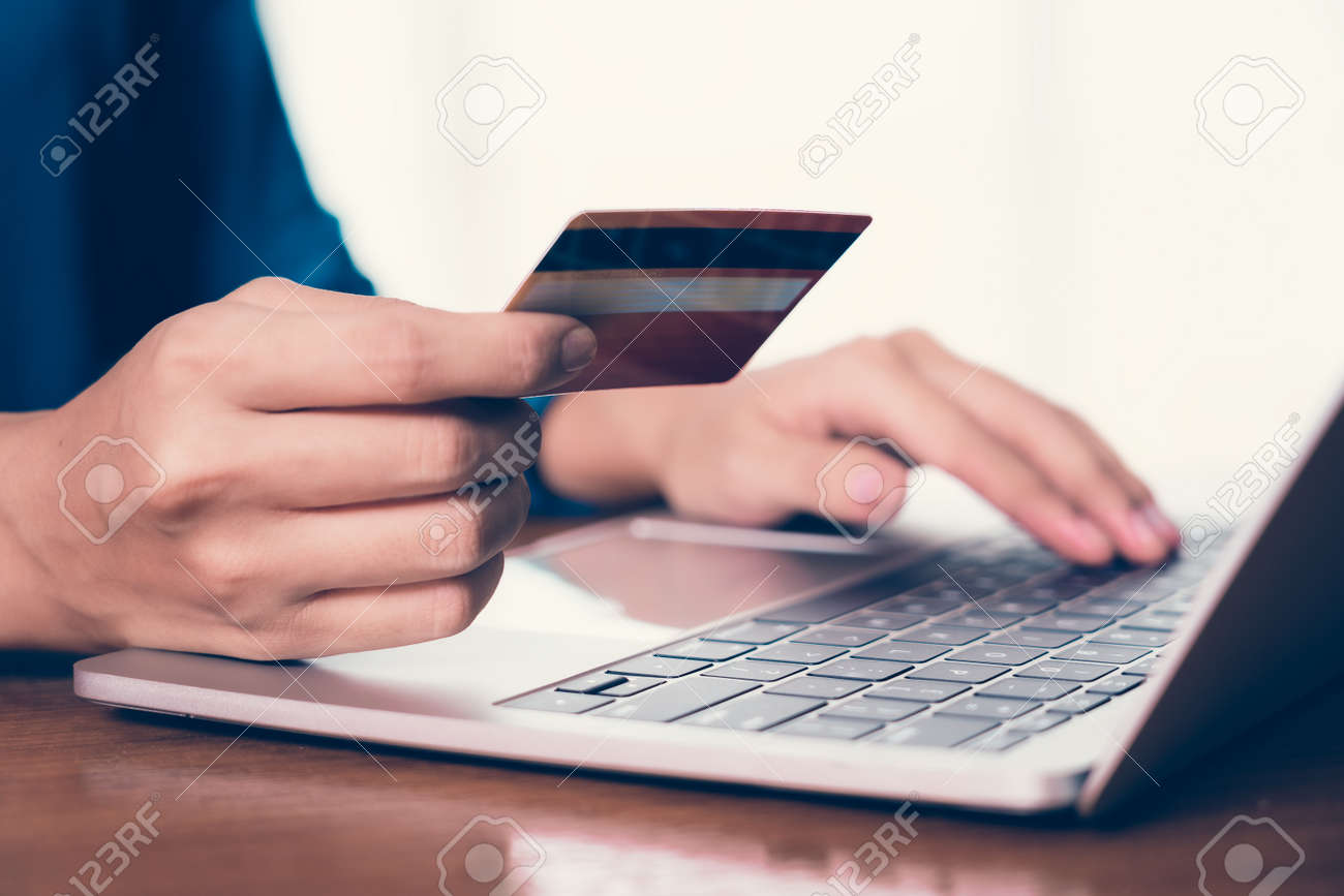 Happy Asian woman shopping online and paying by credit card.technology and ecommerce concept - 170618323