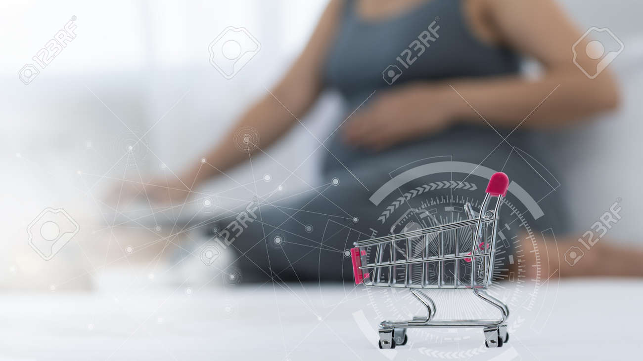 Internet shoopping online and ecommerce concept.pregnant are shopping baby products from online shop. - 170799339