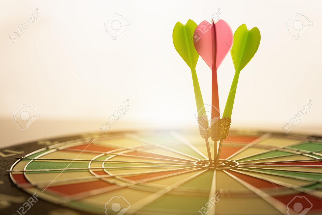 Three arrows hitting on center og dartboard.business goal success concept - 170984280