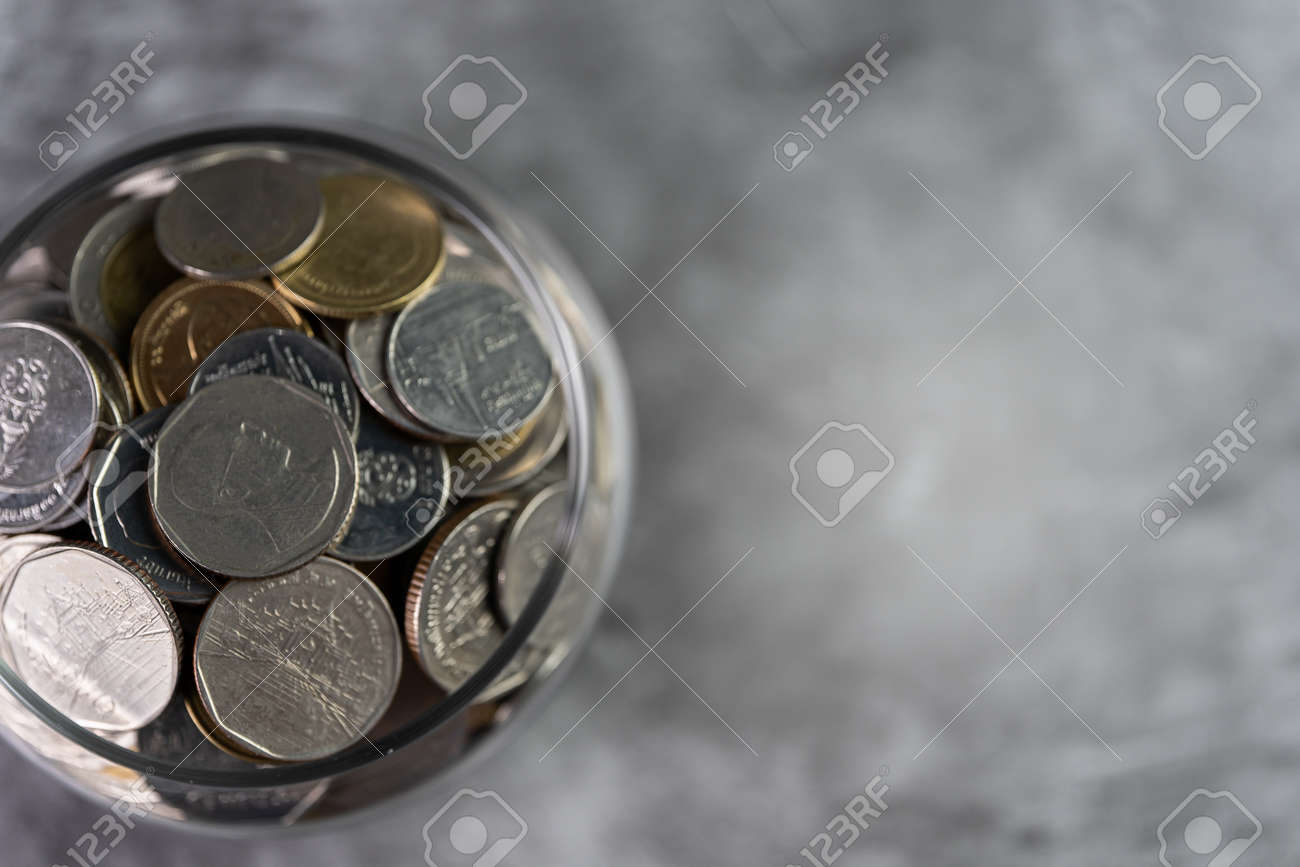 Coins in a glass jar Savings and investment savings - 170974571