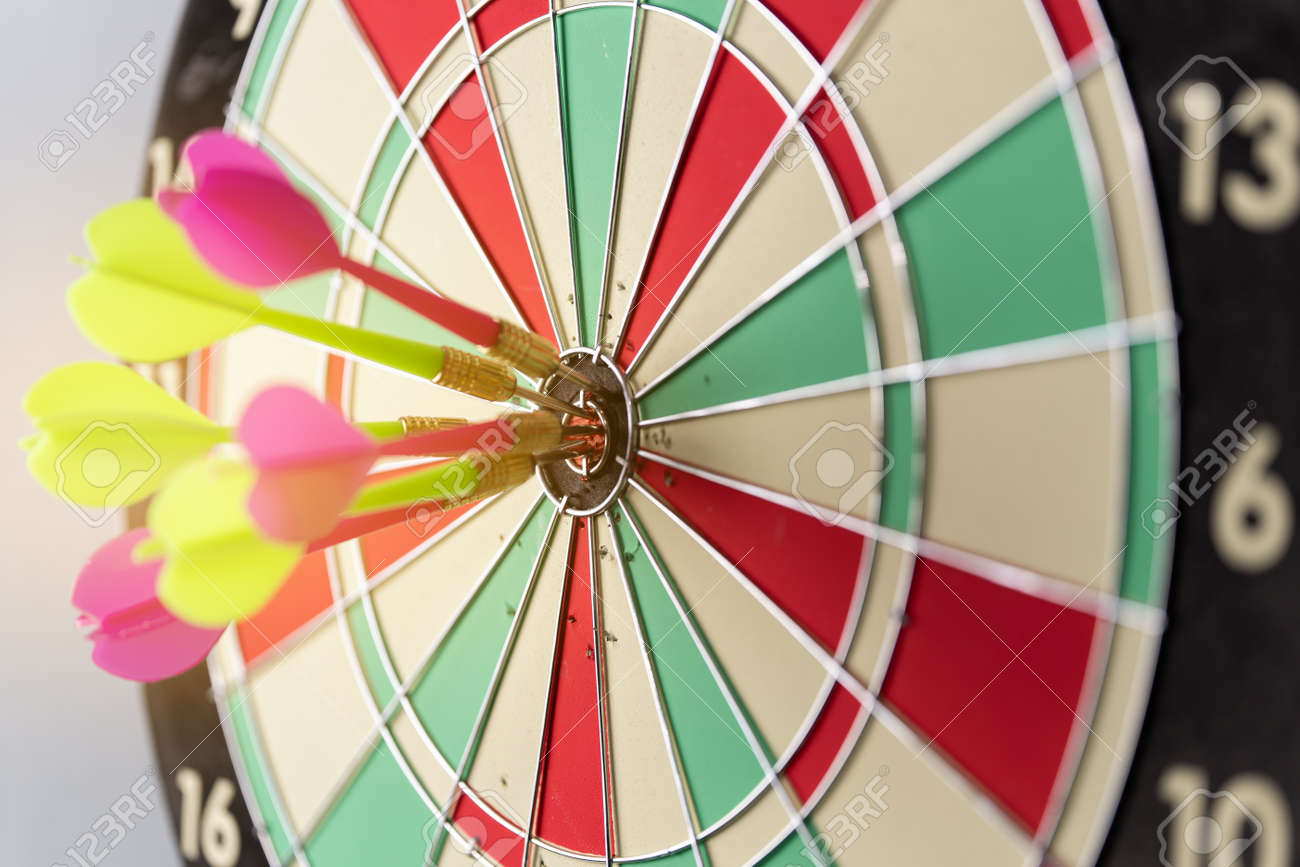 Three arrows hitting on center og dartboard.business goal success concept - 170984393