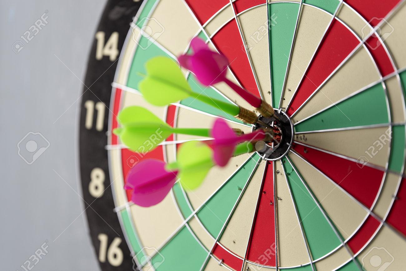 Three arrows hitting on center og dartboard.business goal success concept - 170984400