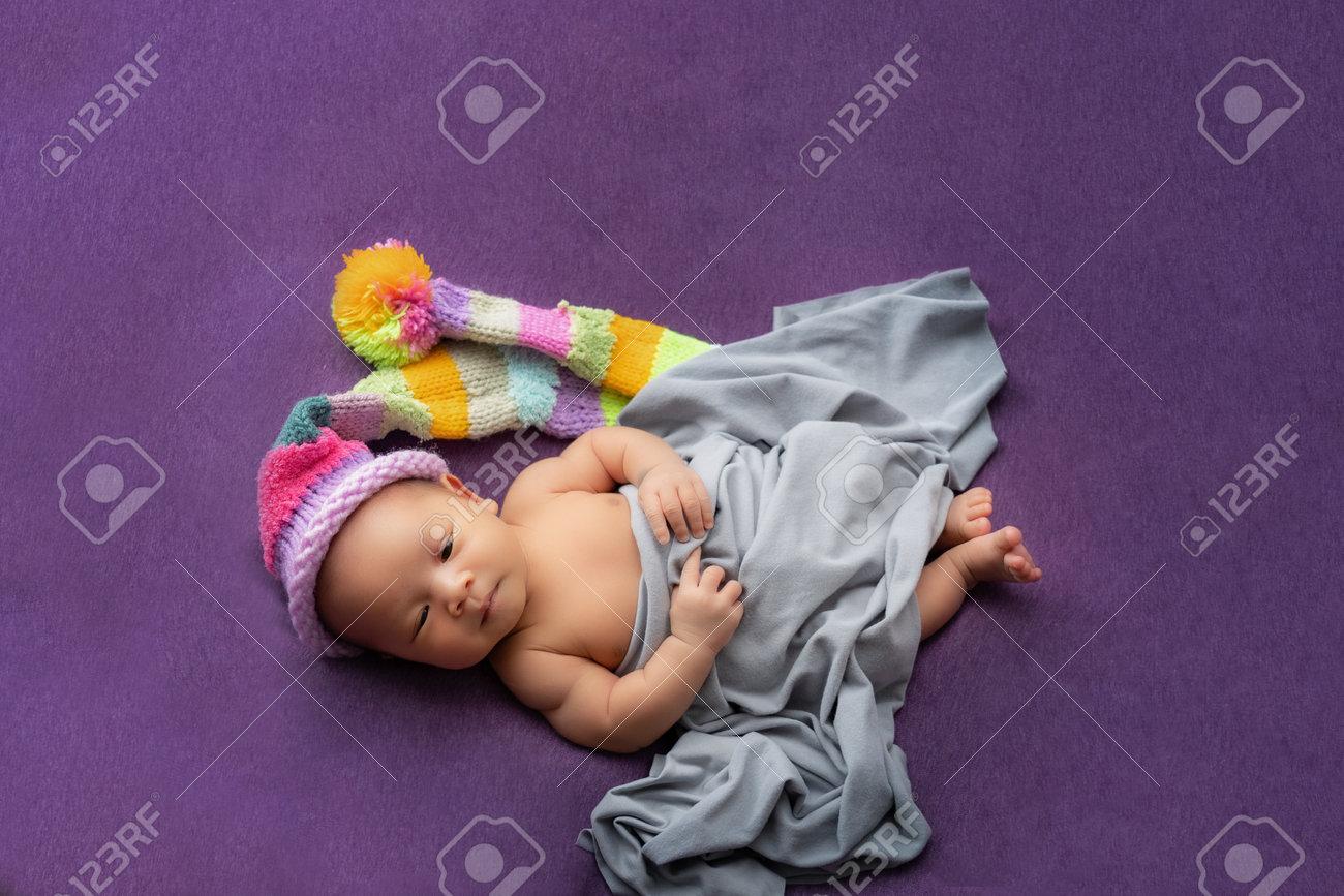 Asian baby newborn on a purple background. - 170984584