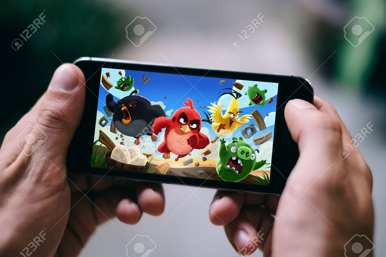 COLOGNE, GERMANY - FEBRUARY 27, 2018: Angry Birds App Game Played On Apple  IPhone Stock Photo, Picture And Royalty Free Image. Image 97263262.