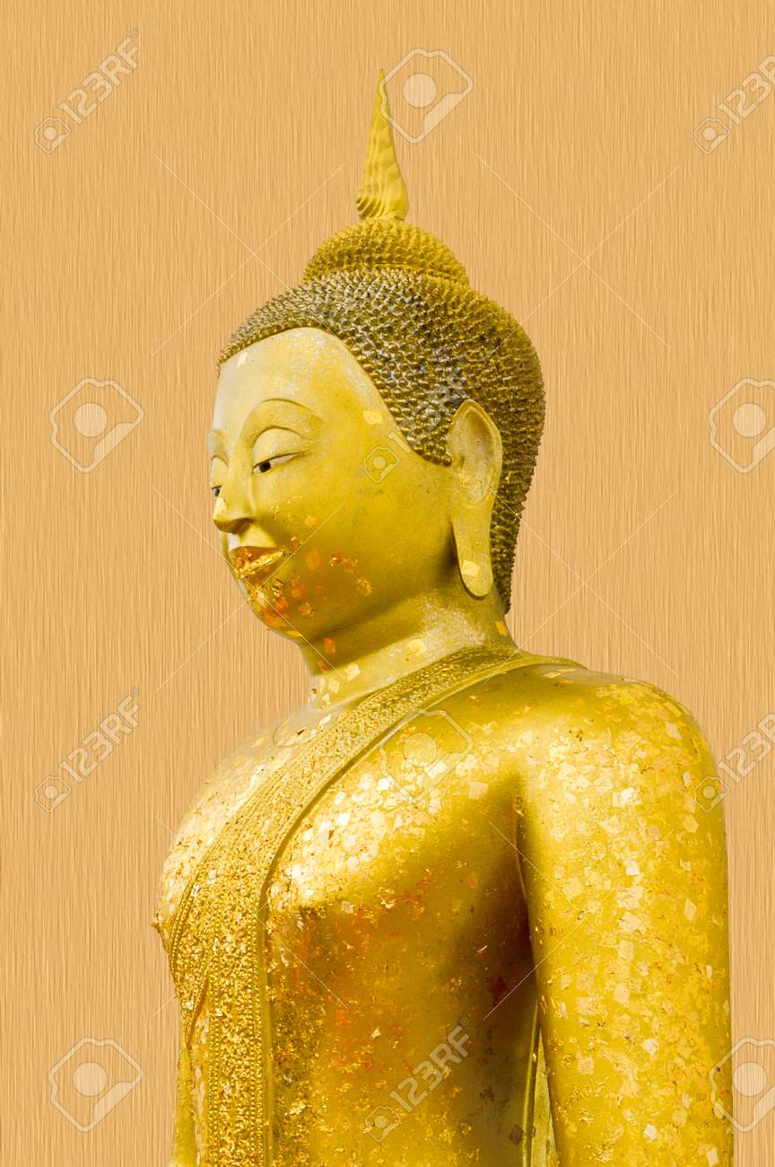 Gold Buddha Statue On Wooden Wall Stock Photo, Picture And Royalty ...