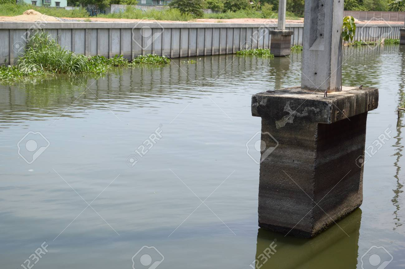 cement post on canal in country Thailand