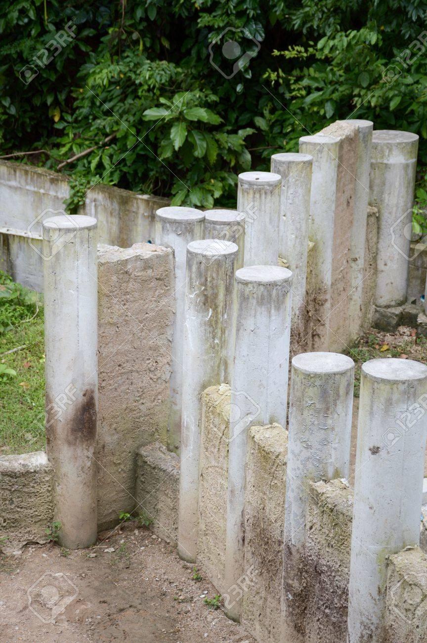 cement post in nature garden