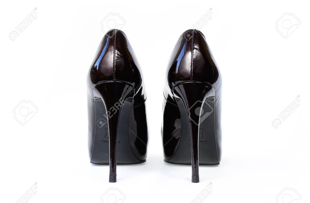 a66ab676860 Lacquered black sexy shoes with high heels isolated on white. Women classic  varnished shoes from