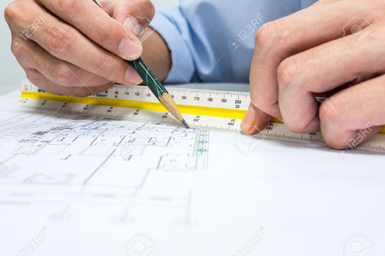 engineer are measuring distance in drawing using pencil and ruler - 42082058