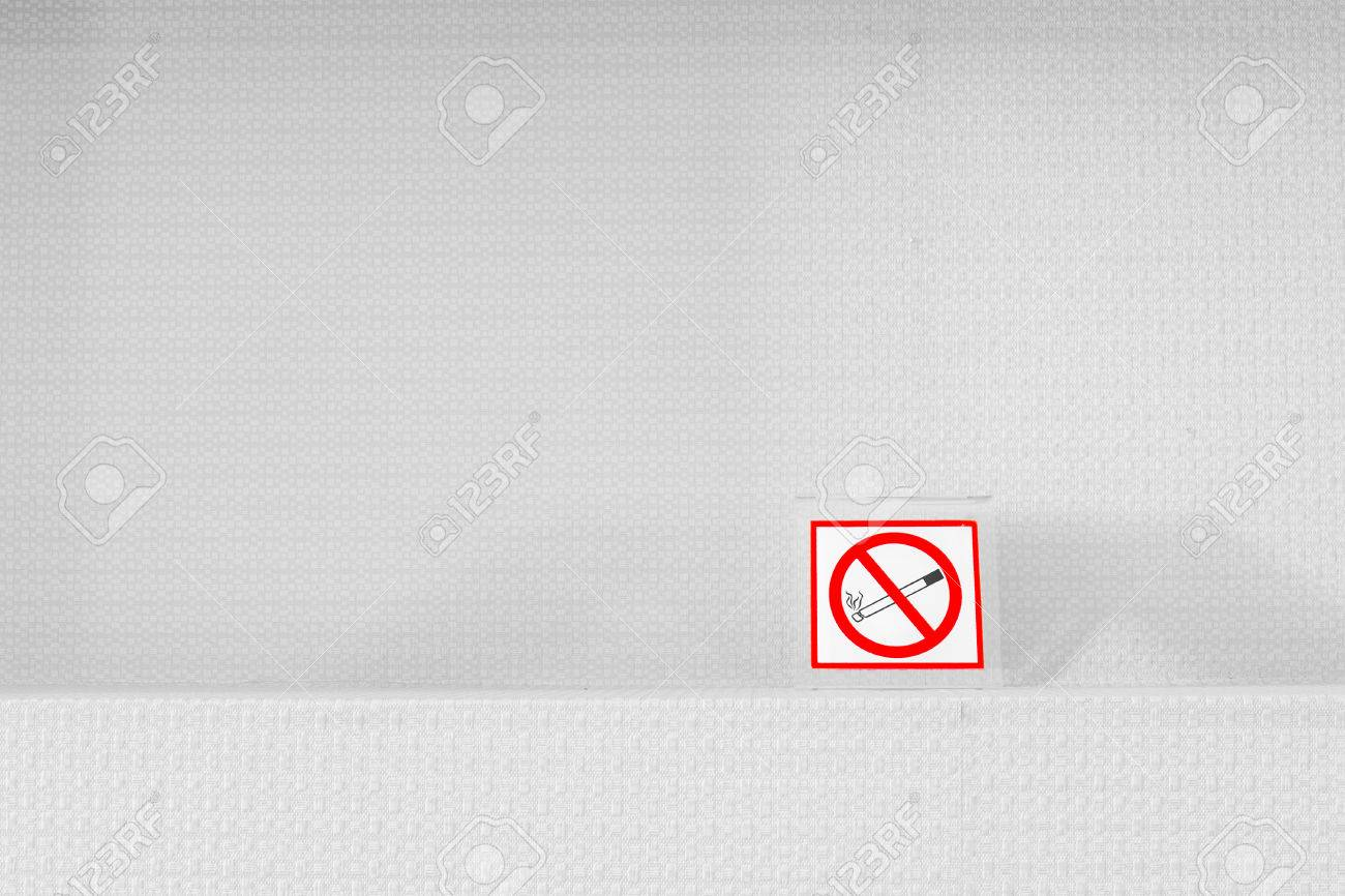 No Smoking Sign Ban On The Shelf And White Wallpaper Texture Background In Hotel Restaurant