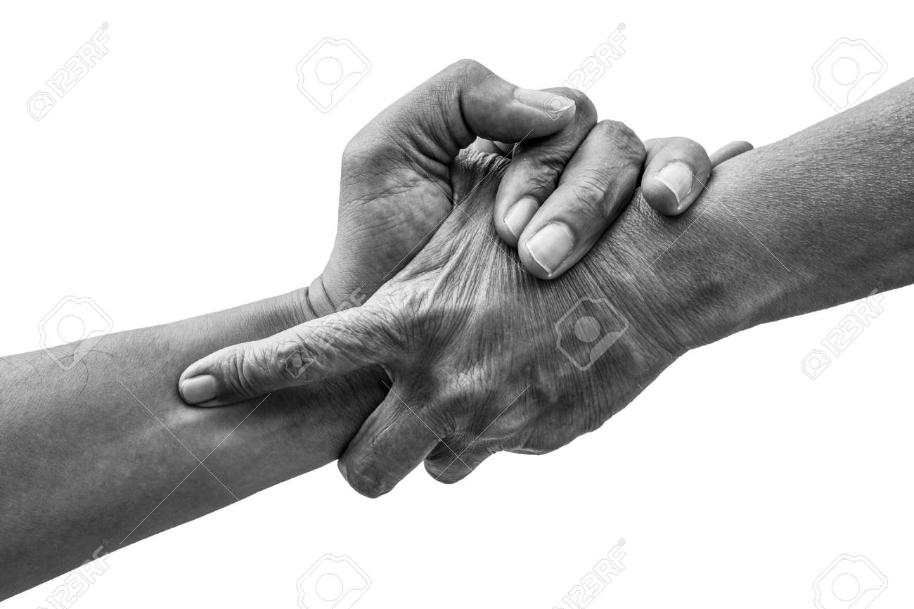 Dramatic black and white help hands holding together representing friendship partnership help and hope