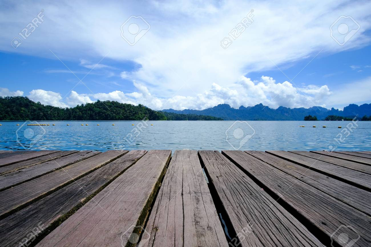 Wooden platform floor with beautiful lake. tropical nature background. - 126261188