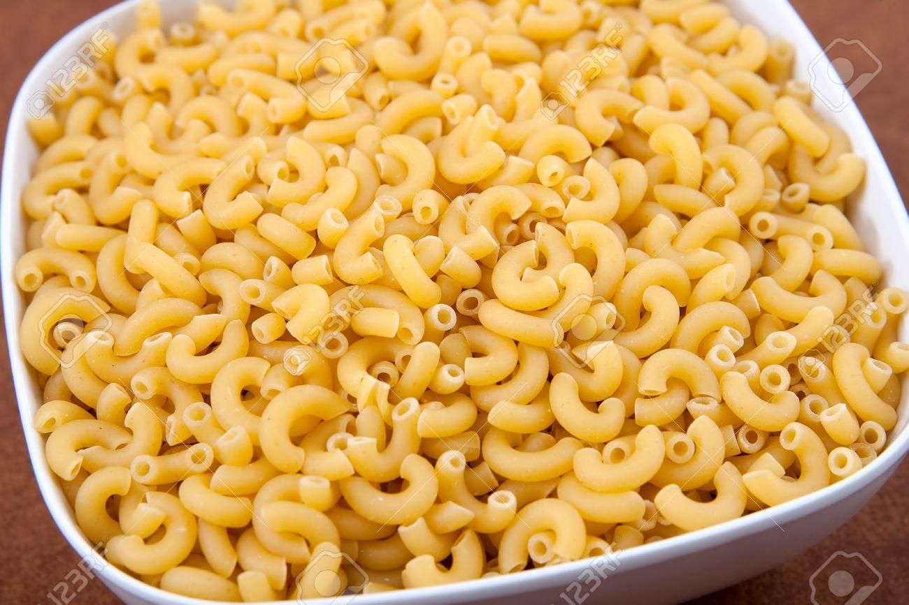 Large White Bowl Of Uncooked Yellow Elbow Macaroni Pasta Closeup Stock Photo 7447882