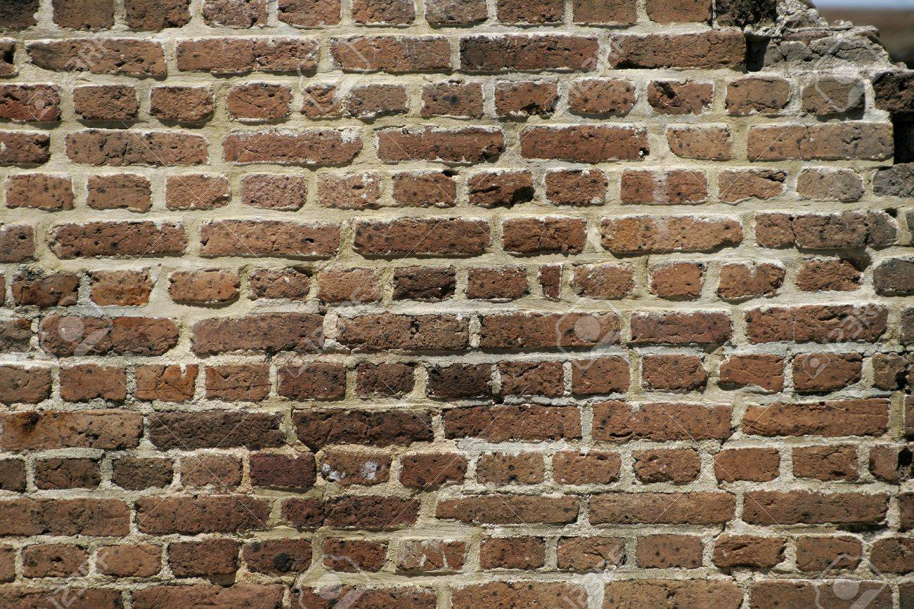dark brown brick wall with opening top right Stock Photo - 7527056