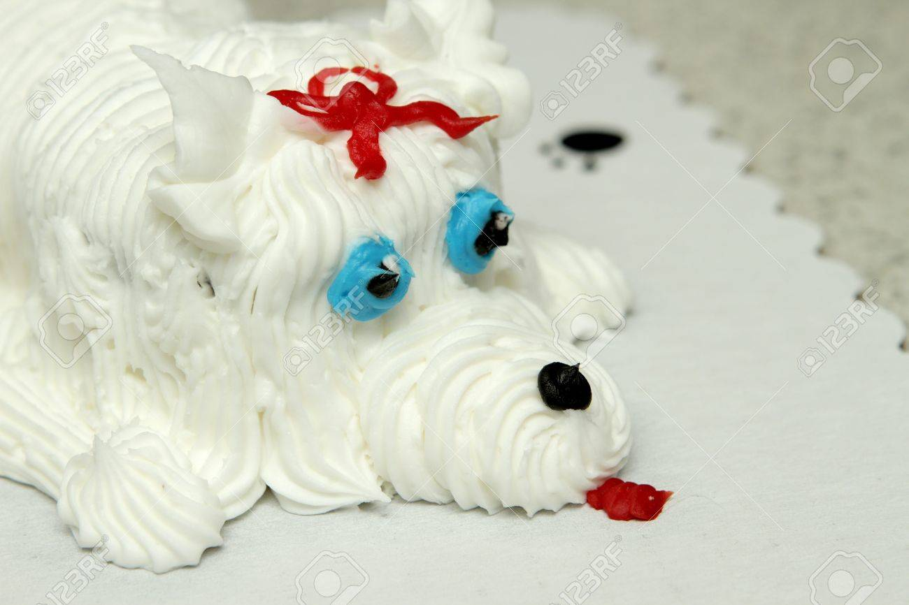 Closeup Of The Face A Birthday Cake In Shape Dog Stock Photo