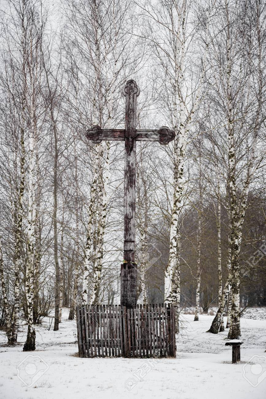 Old Wooden Cross In A Small Park Of Birches In Winter