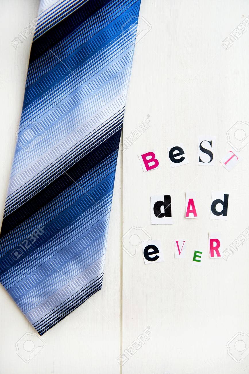Best Dad Ever Letters Cut out from Magazine with Blue Tie laying
