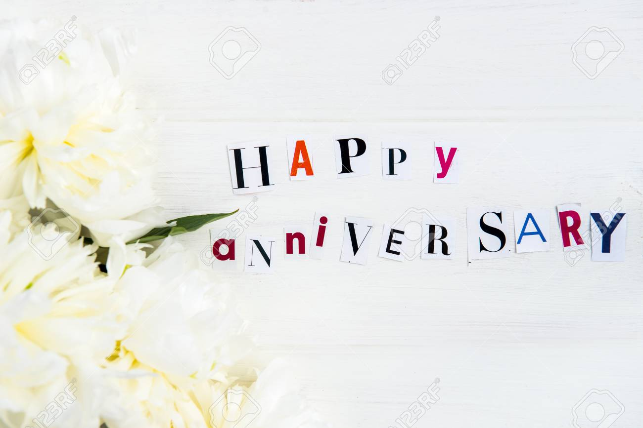 Happy anniversary letters cut out from magazines and white peonies happy anniversary letters cut out from magazines and white peonies nearby white background stock photo spiritdancerdesigns Images