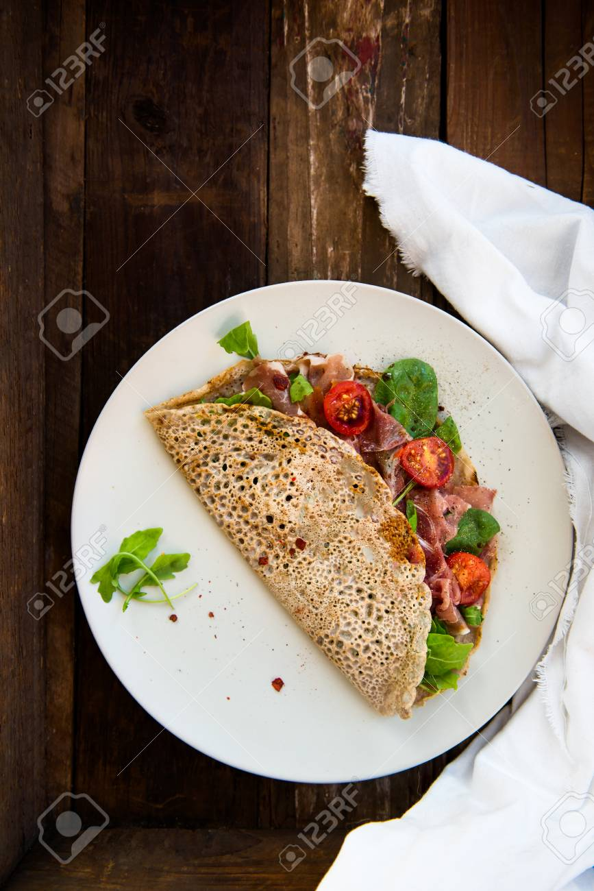 Savoury Buckwheat Pancakes With Cherry Tomatoes Rocket Salad Stock Photo Picture And Royalty Free Image Image 68411780