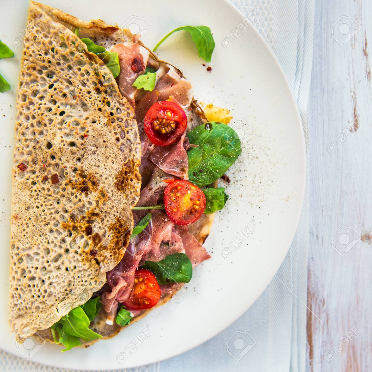 Savoury Buckwheat Pancakes With Cherry Tomatoes Rocket Salad Stock Photo Picture And Royalty Free Image Image 68411762