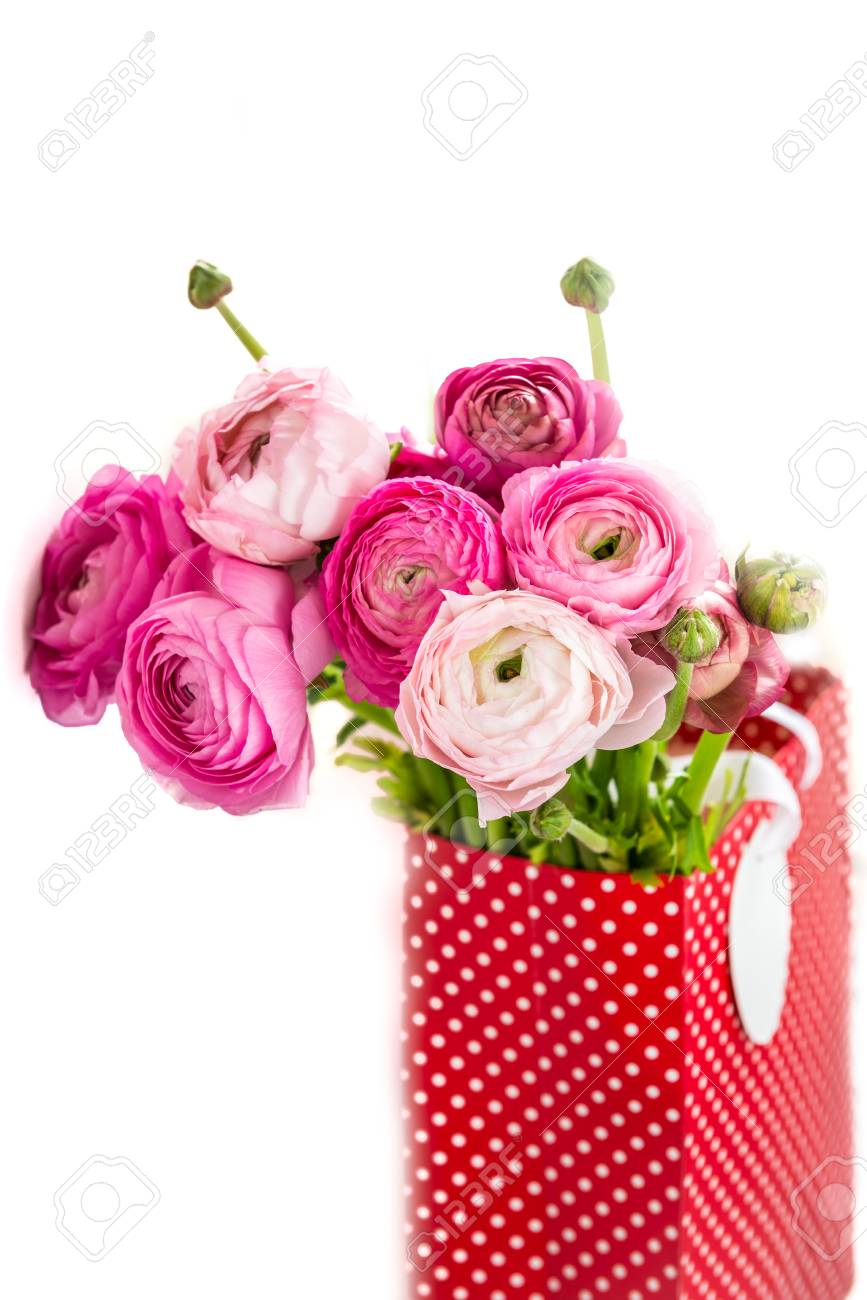 Bunch Of Pink Ranunculus Buttercup Flowers In A Paper Bag For