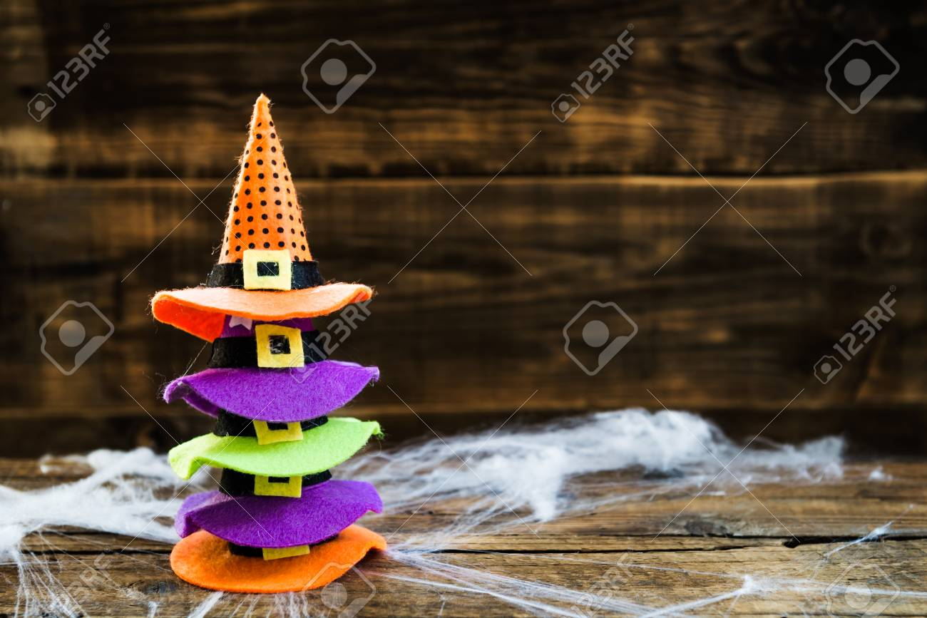 4ec8bf85307 Halloween card concept with stack of cute little witch hats on spider web