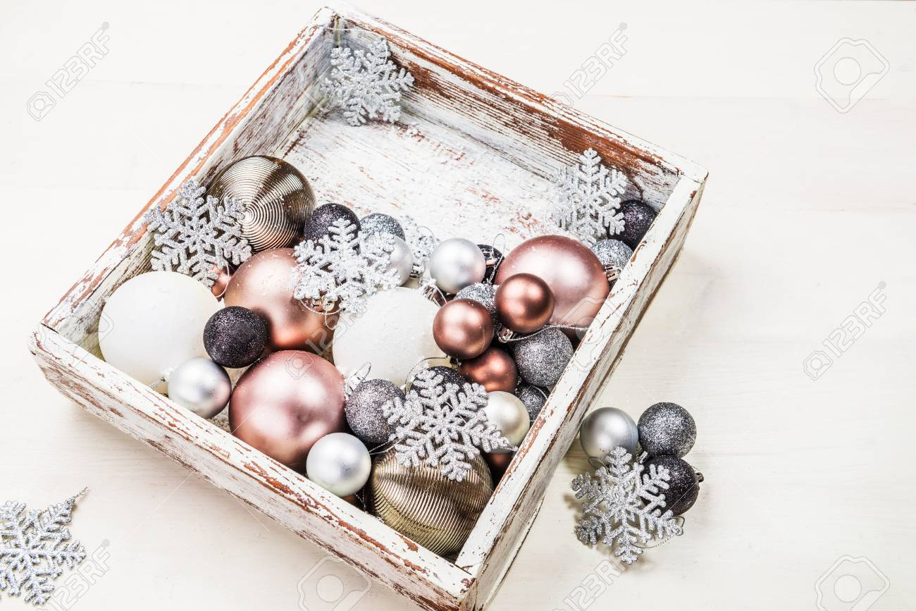 christmas decorations in the wooden box as a preparation for decorating the xmas tree pastel - Pastel Christmas Decorations
