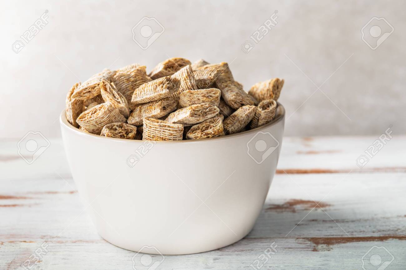 Healthy breakfast in the bowl such as bitesize shredded wheat on light background - 125530148