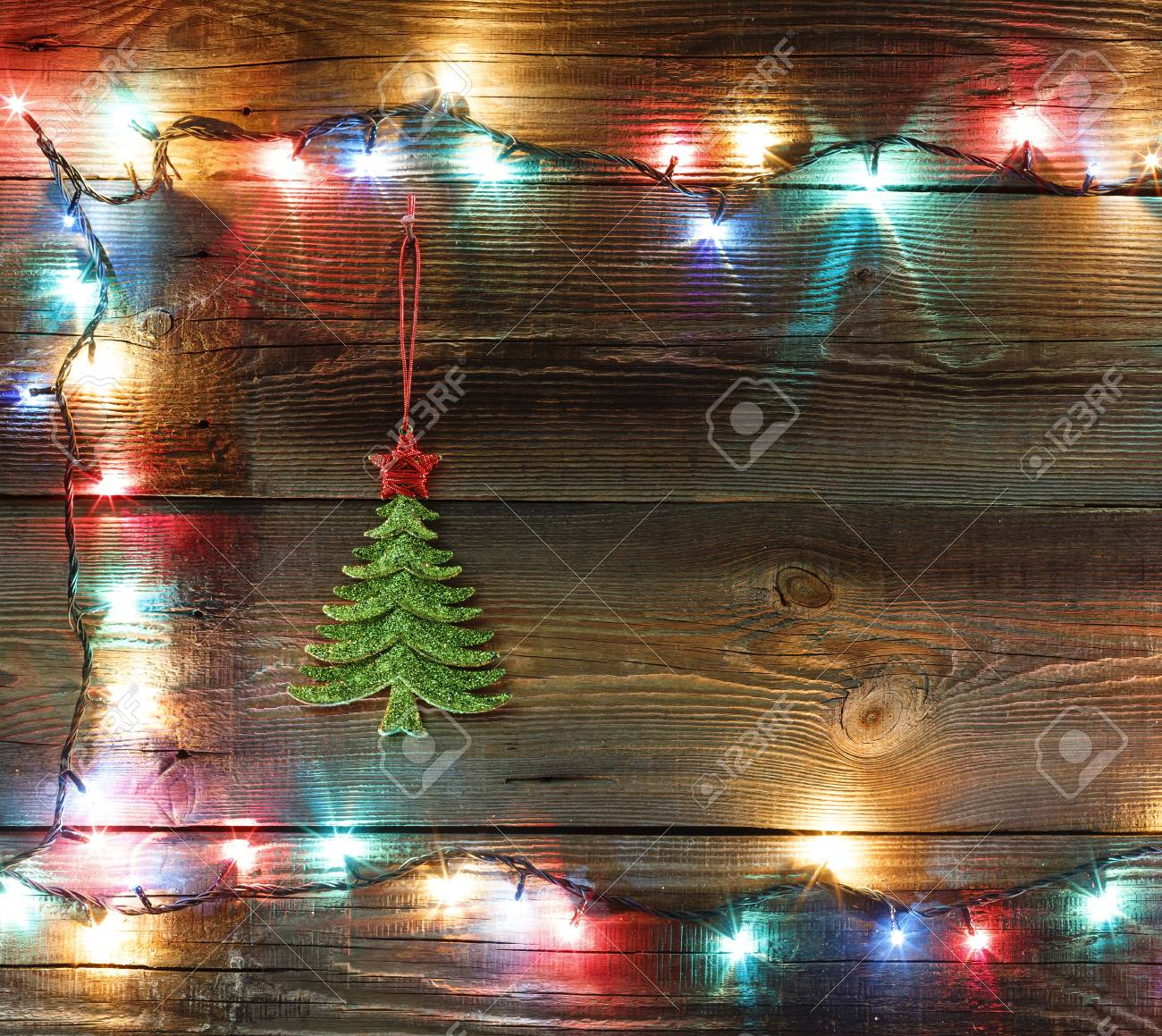 christmas garland with colored lights and lamps on a wooden background christmas tree free space
