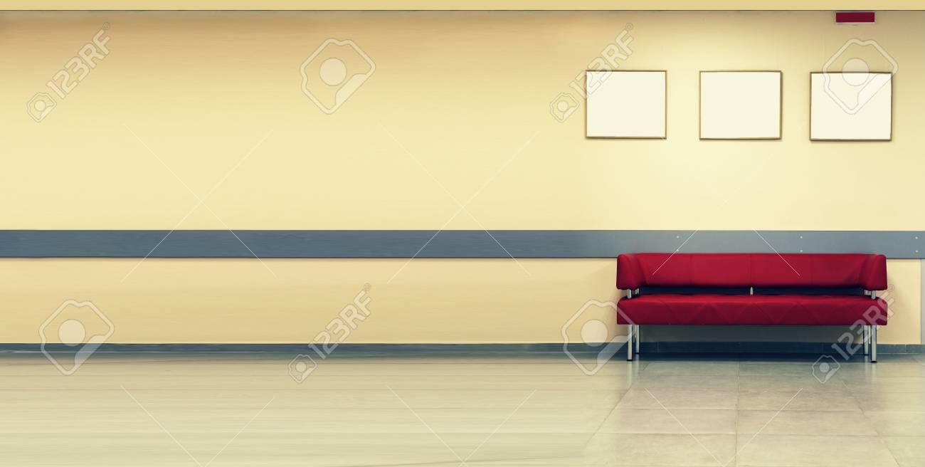Red Sofa, interior design, office. Style minimalism. Empty waiting..