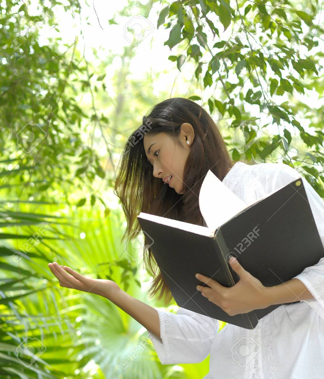 A pretty college girl study on leaves for bio technology - 4808273