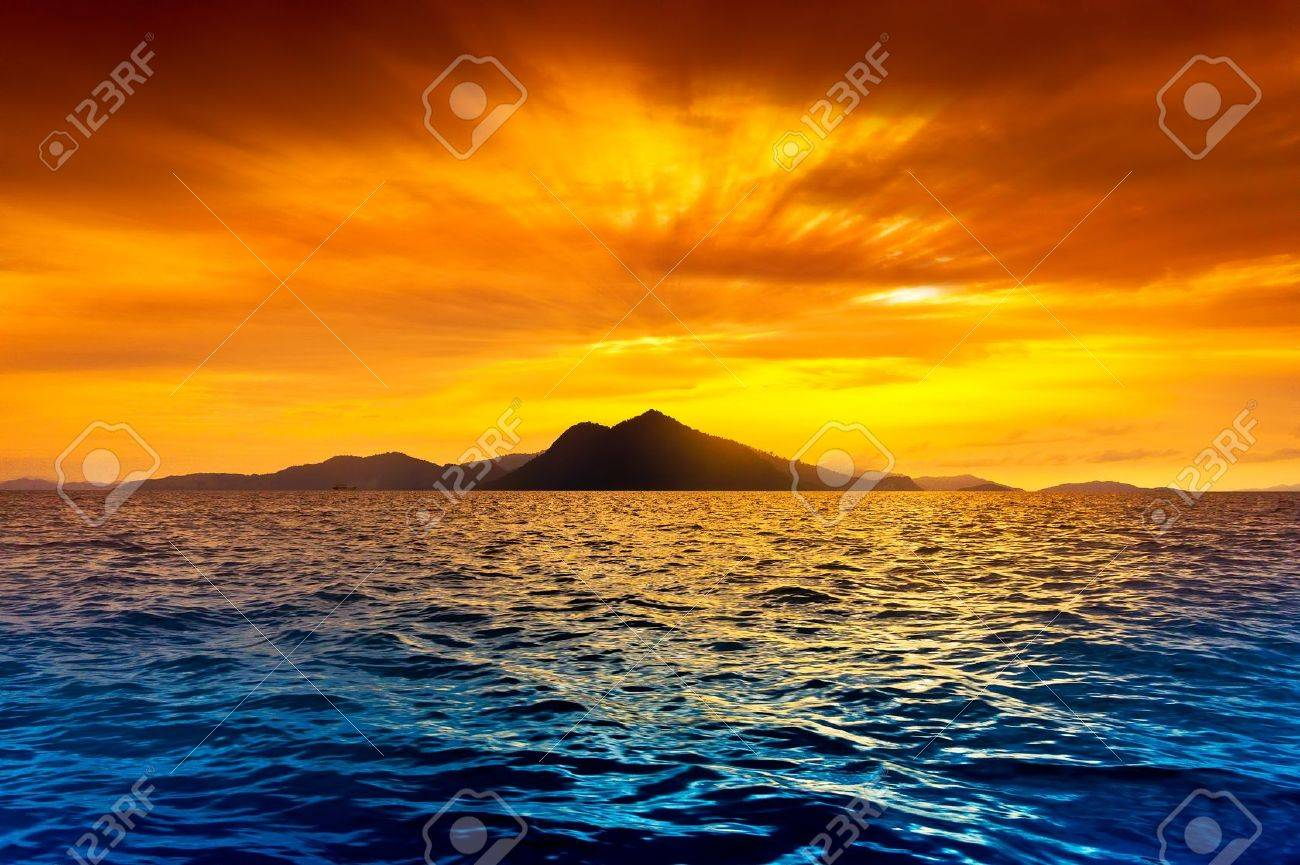 Scenic view of island during sunset - 9538625