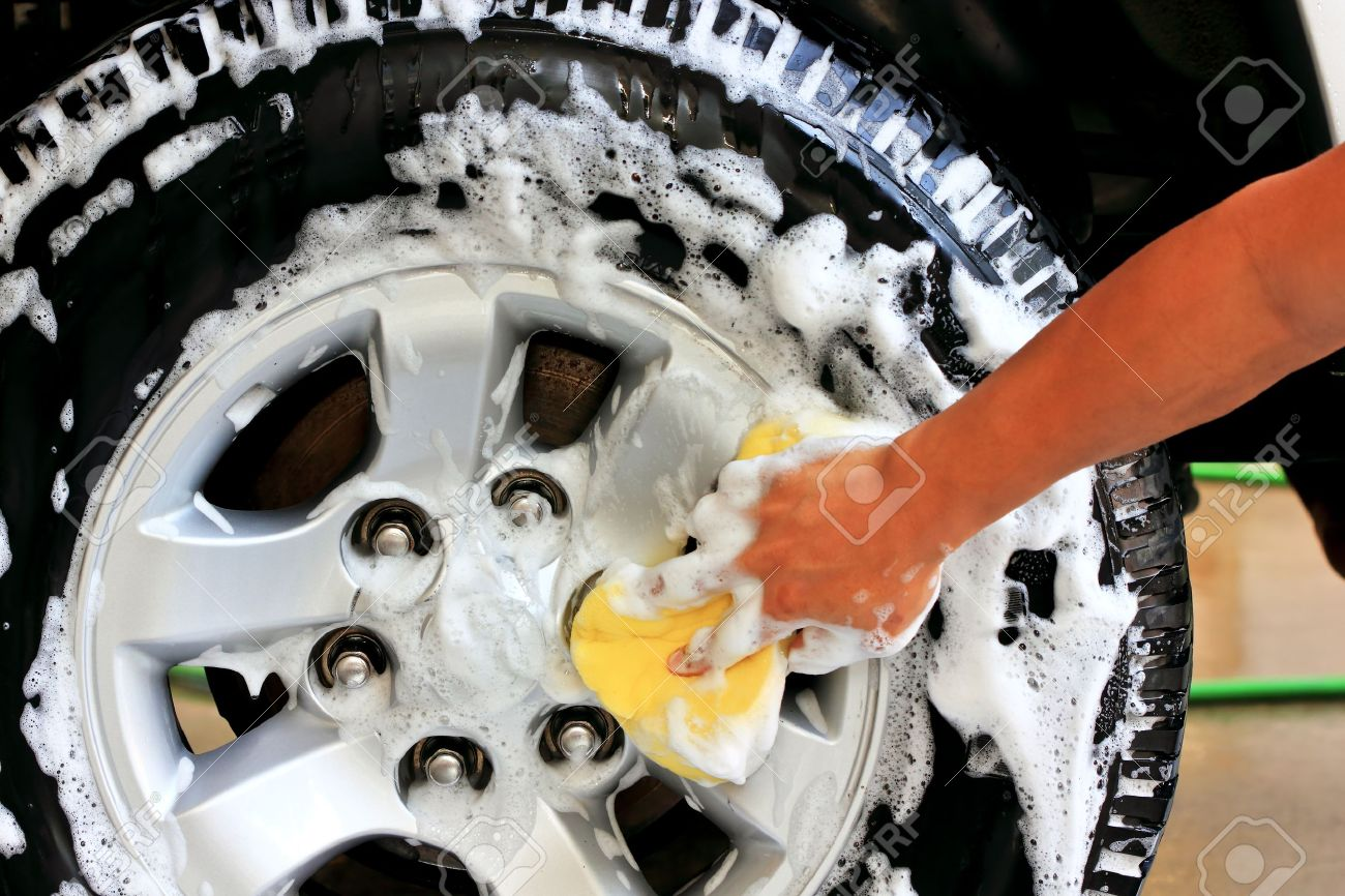 Clean tires with foam and shampoo Stock Photo - 11644731