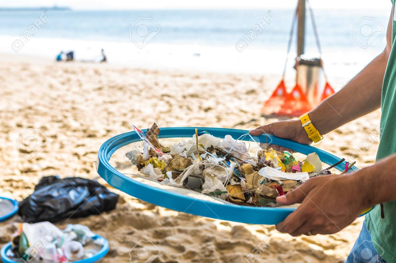 Beach Cleaning. Cleaning dirty beaches by the action of man. Sustainability of the planet and preservation of nature. - 100752120