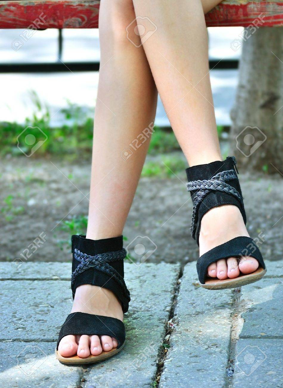 feet of a young girl in summer sandals stock photo picture and