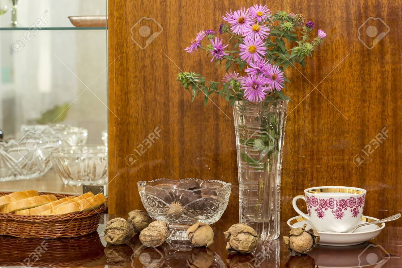 Superb Crystal Vases With Flowers Candy And Nuts On A Polished Surface Interior Design Ideas Grebswwsoteloinfo