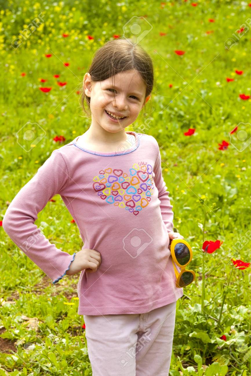 girl  in a green field with Anemone flowers Stock Photo - 10745902