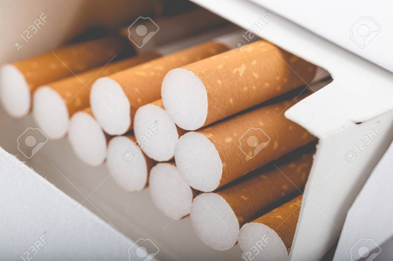Side view of a pack of cigarettes with faded filter - 61252857