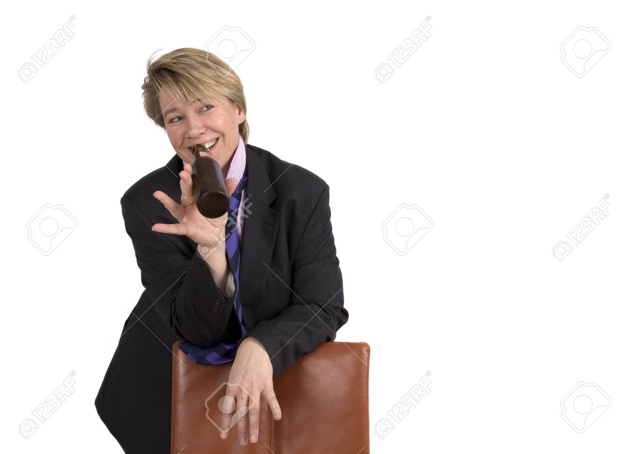 A businesswoman is having a drink after a major succes. Looking at her left. This space can be used to fill with e.g. text. On white background. Stock Photo - 388580