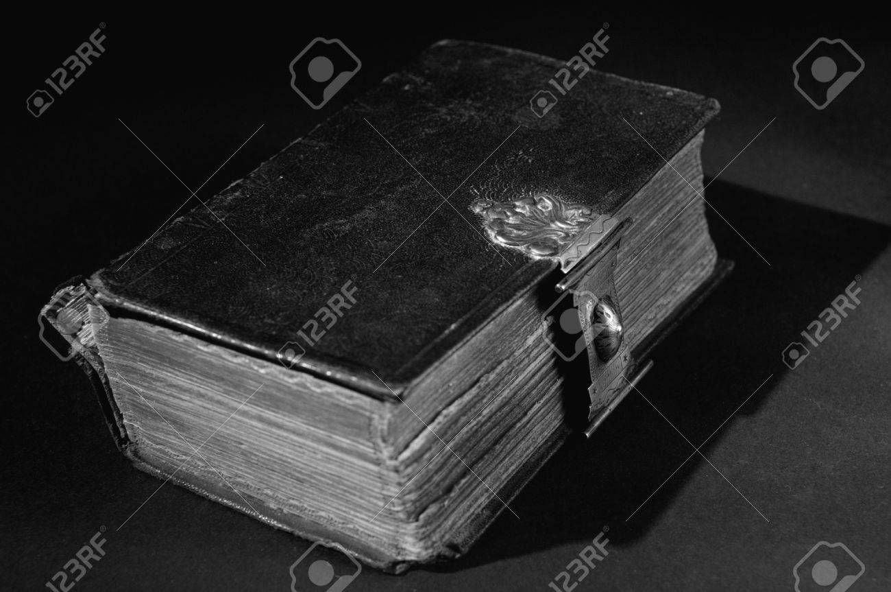 Nice Old Bible With An Lock On A Black Background In White