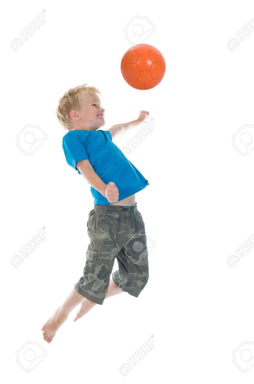 Young boy going to make a header. Will he score? Isolated on a white background. Little movement in arms and legs. Stock Photo - 7621215