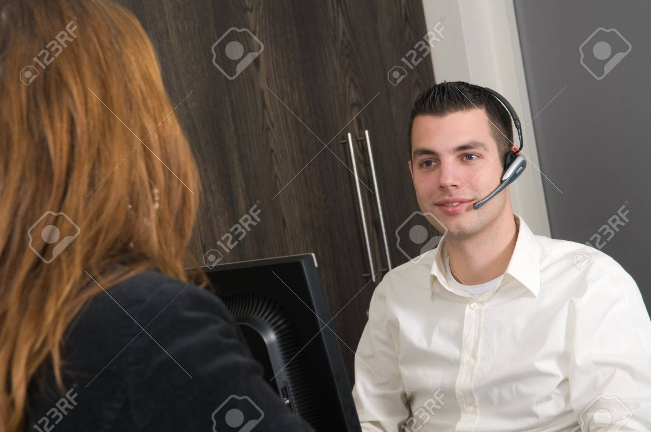 Customer getting some information at a service desk Stock Photo - 12024655